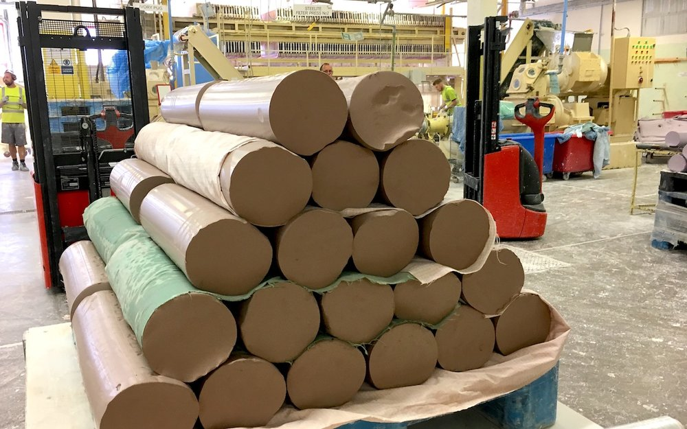 At the beginning of the process, long rolls of clay are called 'pugs'