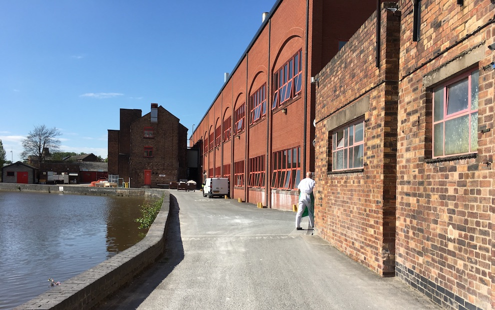 A canal runs through the middle of the factory grounds