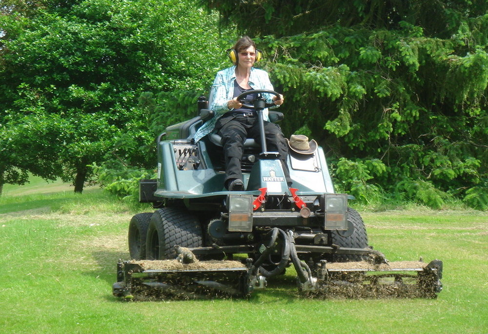 Millie on the mower during her gardening apprenticeship. Image supplied by Millie.