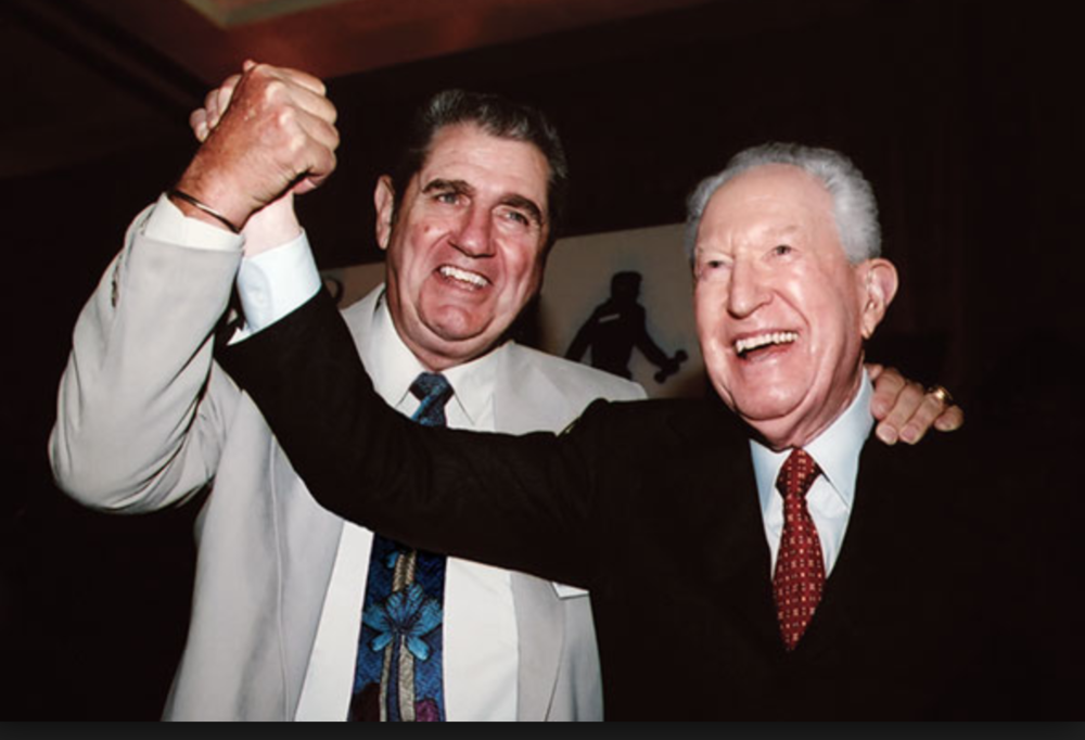 Jim Moran at the 2005 YATC Graduation with Miami Dolphins legend Earl Morrall, a loyal friend and longtime supporter of the school.