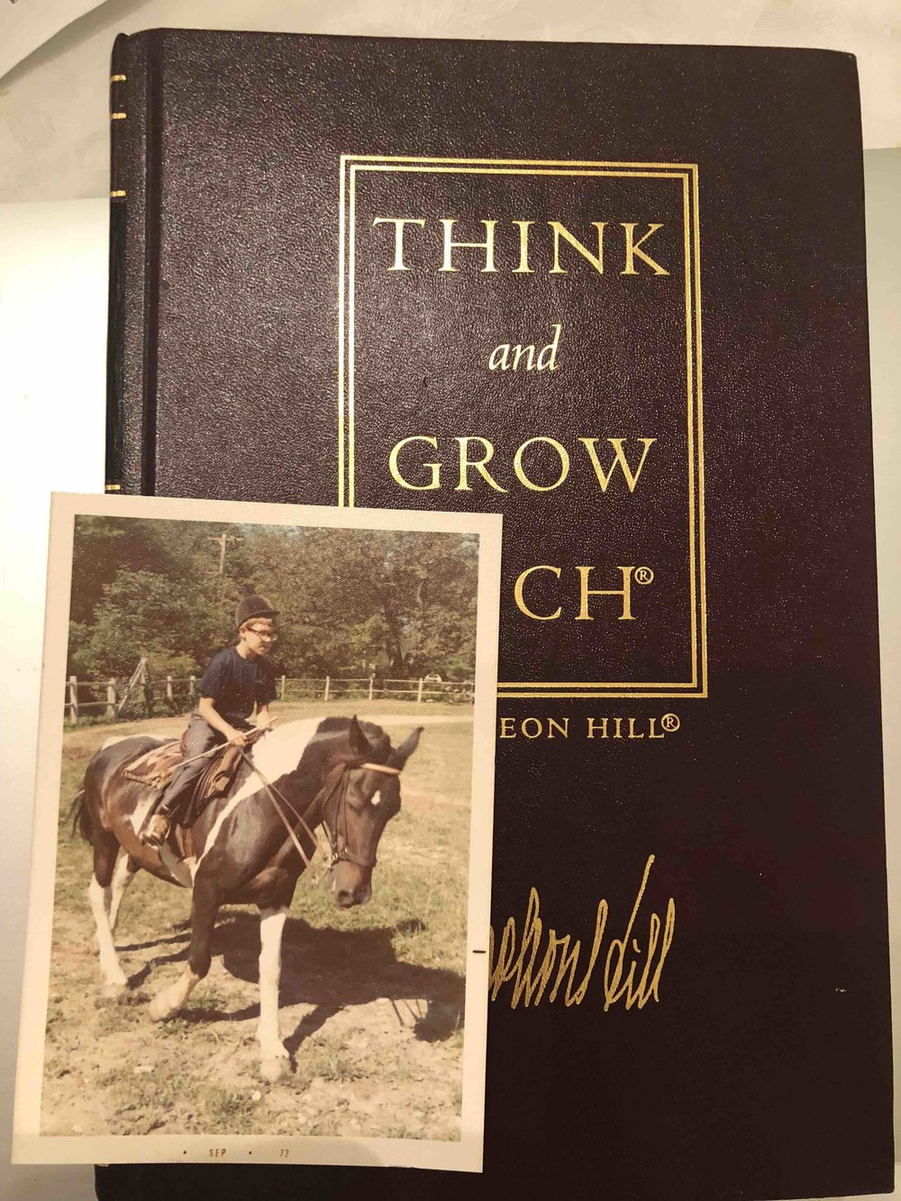 """This is my earliest Collector's Edition of """"Think and Grow Rich, circa 1972. Yes, that's me riding my horse """"Outrageous"""", I must have been about 10 years old!"""