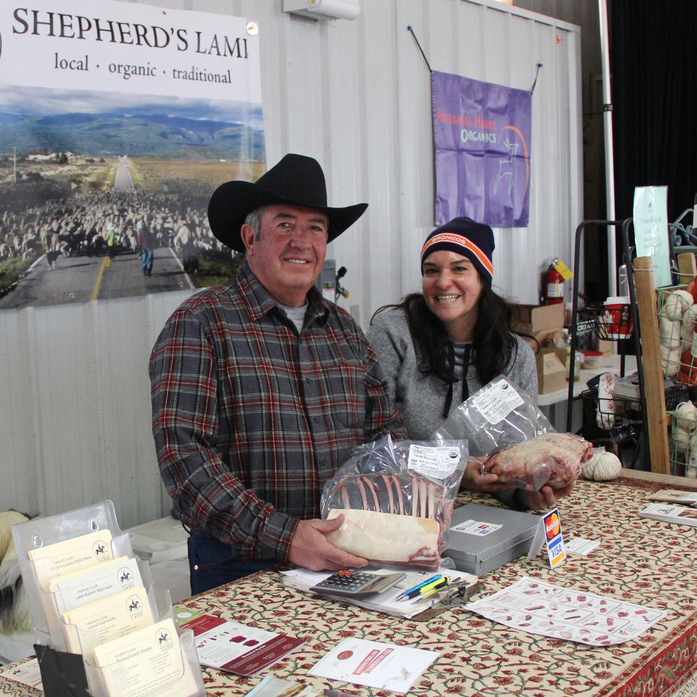 Antonio and Olivia showcase Shepherd's Lamb at the Santa Fe Farmers Market.