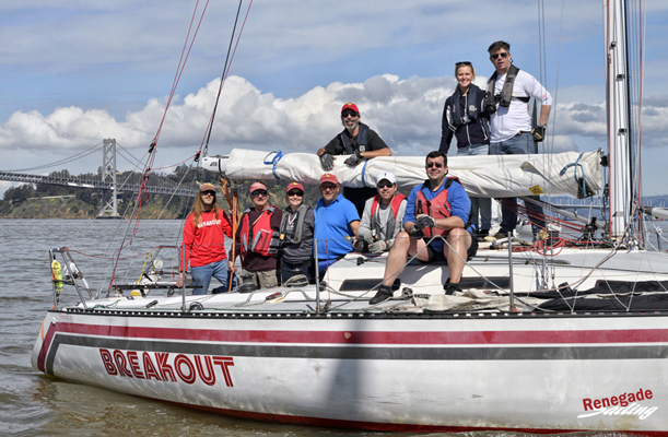 The crew on BREAKOUT,  Santana 35 owned by Lloyd Ritchey, is ready for a photo.