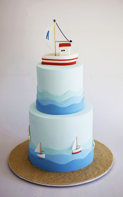Smooth sailing for Helena Kastanis of  Sweet Tiers  and her christening cake for Alexandros. Waves of blue fondant lap around both tiers, and little boats with rice paper sails head to the races. Helena is based in Melbourne, Australia. Aside from top sailors, seems the country has winning cake decorators too.  http://cakesdecor.com/SweetTiers