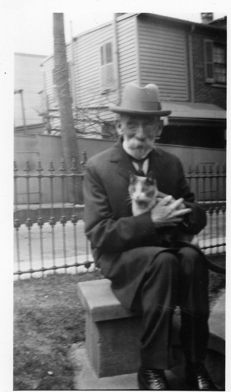 James Bull behind the building holding a cat :)