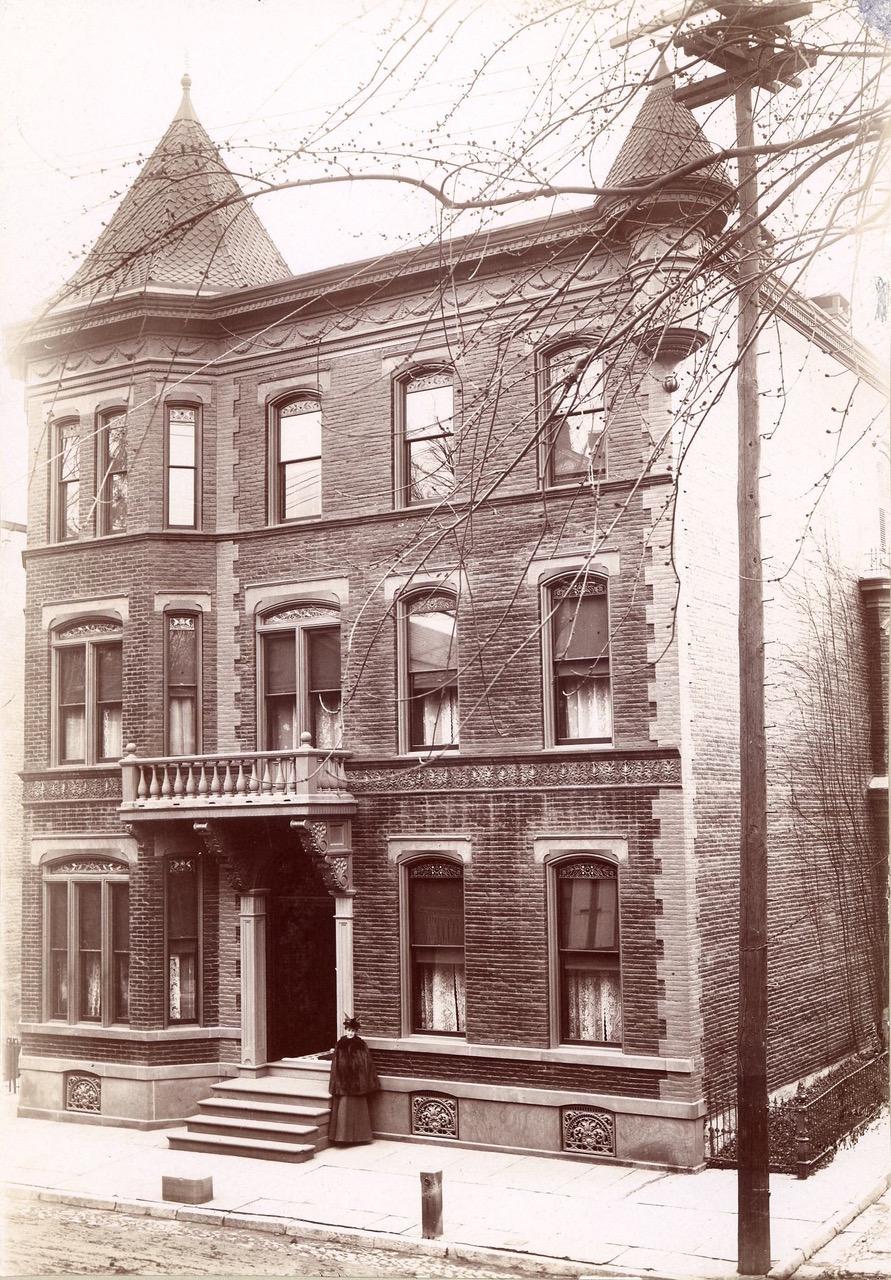Mary Bull outside of Bull Mansion, 1896.