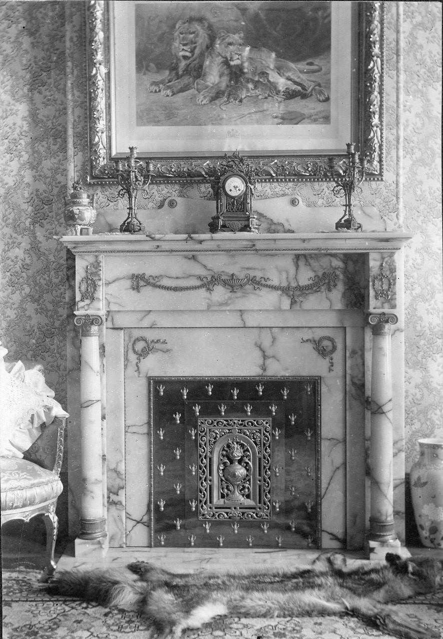 The interior of the Bull family parlor, with one of the two original white onyx fireplaces.