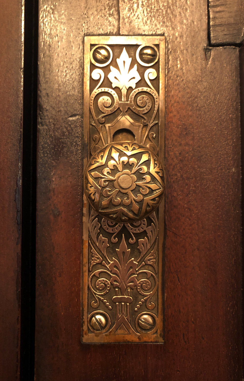 Cast bronze flush bolt on the front door made by Russell & Irwin in 1885.