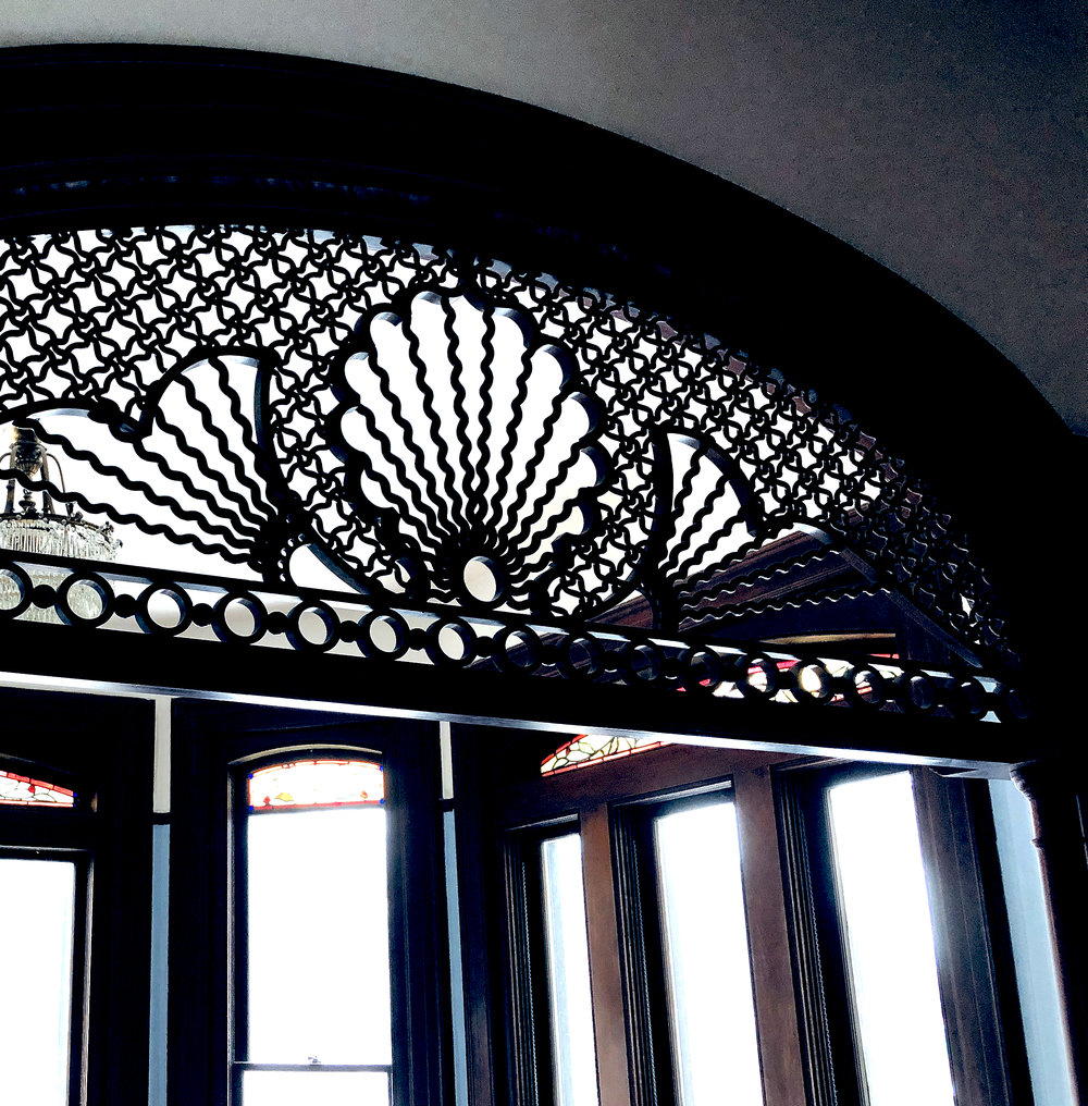 A delicate carved wooden screen in what was once a sitting area