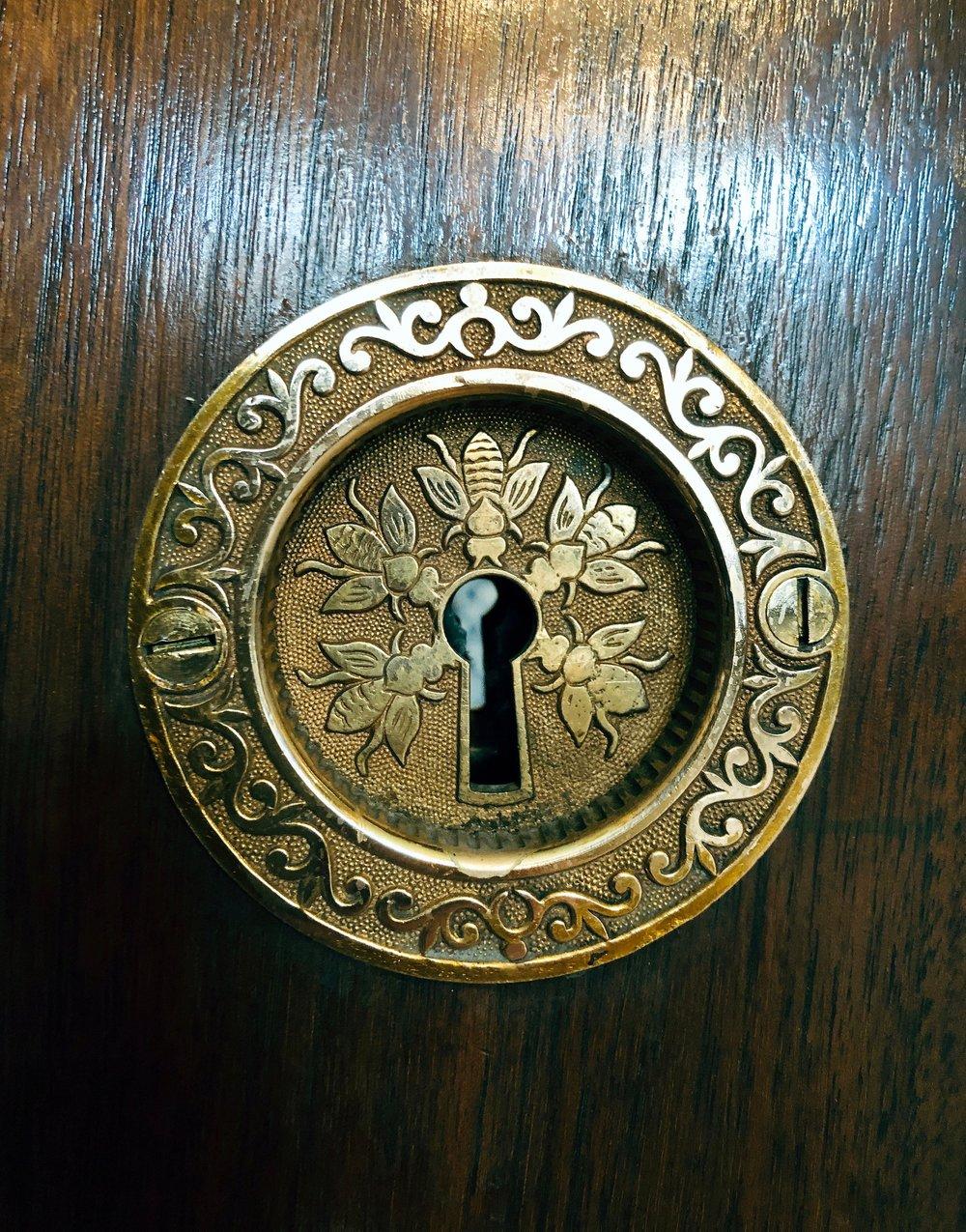 Bee design pocket door lock, made by Mallory Wheeler in 1884