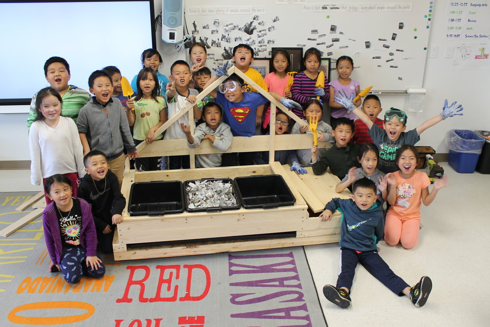 Completed! - CSE second graders with their vermicompost system.