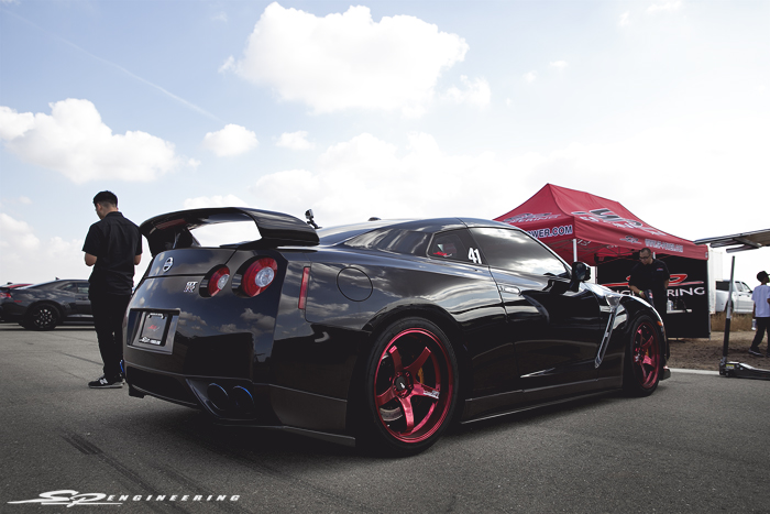 Louie's GT-R is a neck breaker.  The candy apple red Advan GT's seriously stands out on this menacing machine.