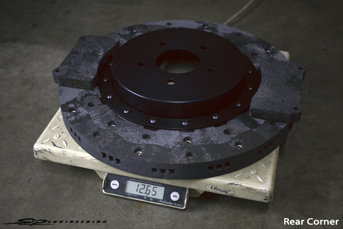 Weight comparison between steel rotors and carbon-carbon rotors.  So much weight shed in each corner.  Very racing.  Wow.