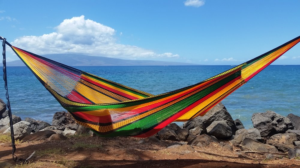 "(Contact us for colors available as they change daily)  Referred to as the ""Super Jumbo"" in size,  this hammock is extra comfy for 1 and perfect for 2 people with a weight support of 500+ lb..  Ultra soft, hand woven triple acrylic hammocks can be left outdoors without worry of them losing color or shape. The Thai Laying Hammock weaving process takes up to 2 weeks to create. This weatherproof hammock is ideal for any outdoor area, great for the beach or lounging by the pool. Luxuriously soft and comfortable. Come rain or shine, you can leave it outdoors and the colors stay bright for many years. The Thai laying hammock is available in many unique designs and colors not seen in any other hammocks in the world.  We label these hammocks after our favorite towns on Maui."