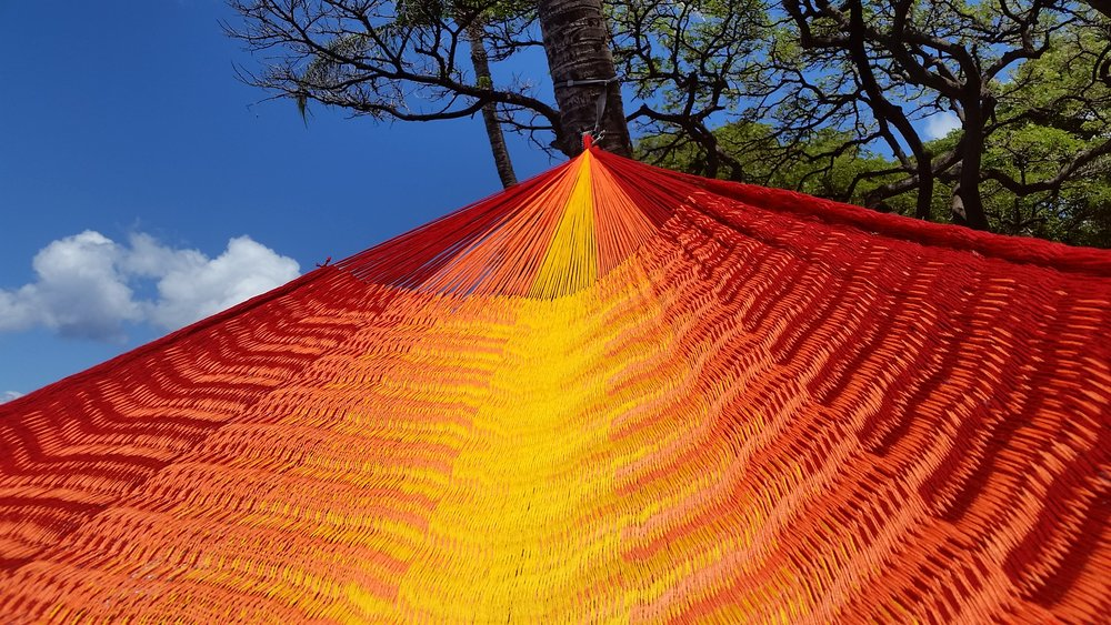 "(Contact us for colors available as they change daily)   Referred to as the ""V-Weave"",  this hammock is considered to be the Rolls Royce of hammocks.  Extra large and luxurious.  The V-Weaveing technique causes a subtle color change when the hammock is in motion.  The densely woven technique results in a hammock that is incomparable in both comfort and beauty.  It takes a specialist weaver up to 3 weeks to produce just one of these hammocks.  From 3km of yarn and over 150,000 loops, woven with ultra soft triple acrylic yarn.  This hammock is the worlds finest.  We carry a very limited number of these a year. We label each hammocks after our favorite surf breaks.  Kicking back in one of these hammocks while enjoying an afternoon admiring the scene, is sure to make an impression."