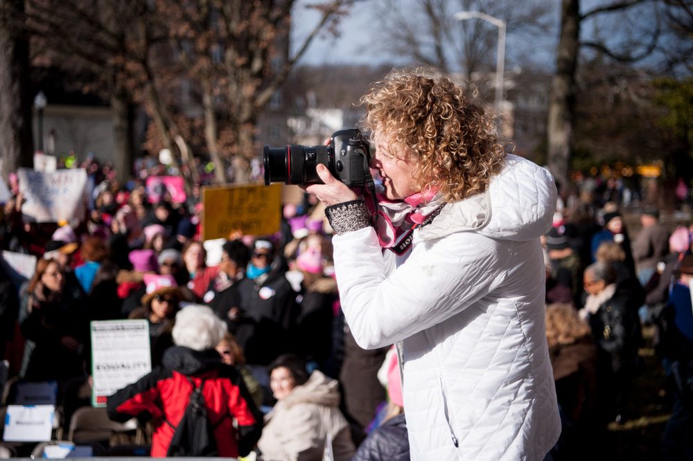 One from the team of volunteer photographers perched above the crowd, Women's March on NJ