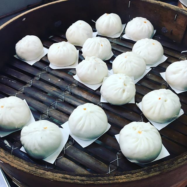 Learning the ins and outs of Pau. Steamed char siu buns ready to serve in large bamboo steamers.