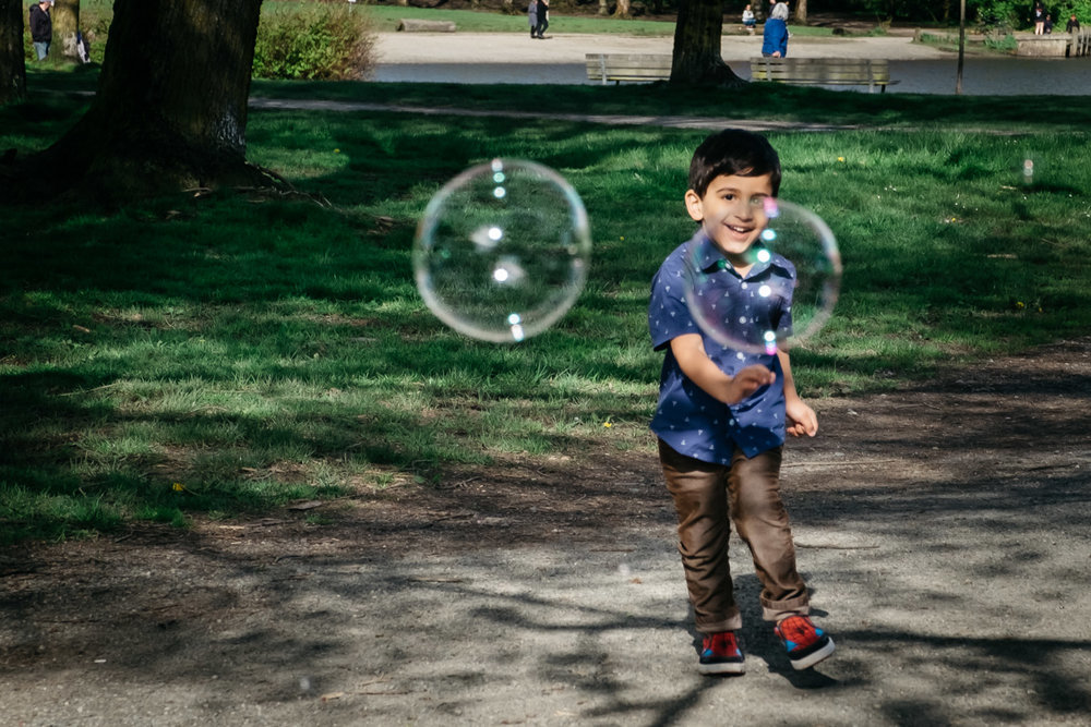 Boy chasing bubbles - Vancouver Family Session