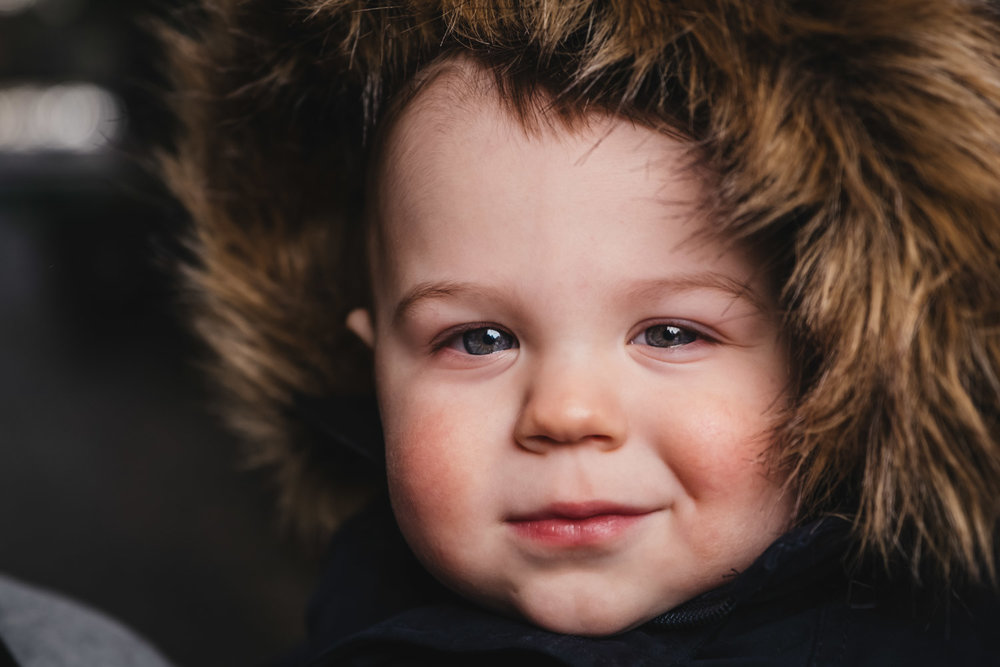 Cute one year old boy in family photo session