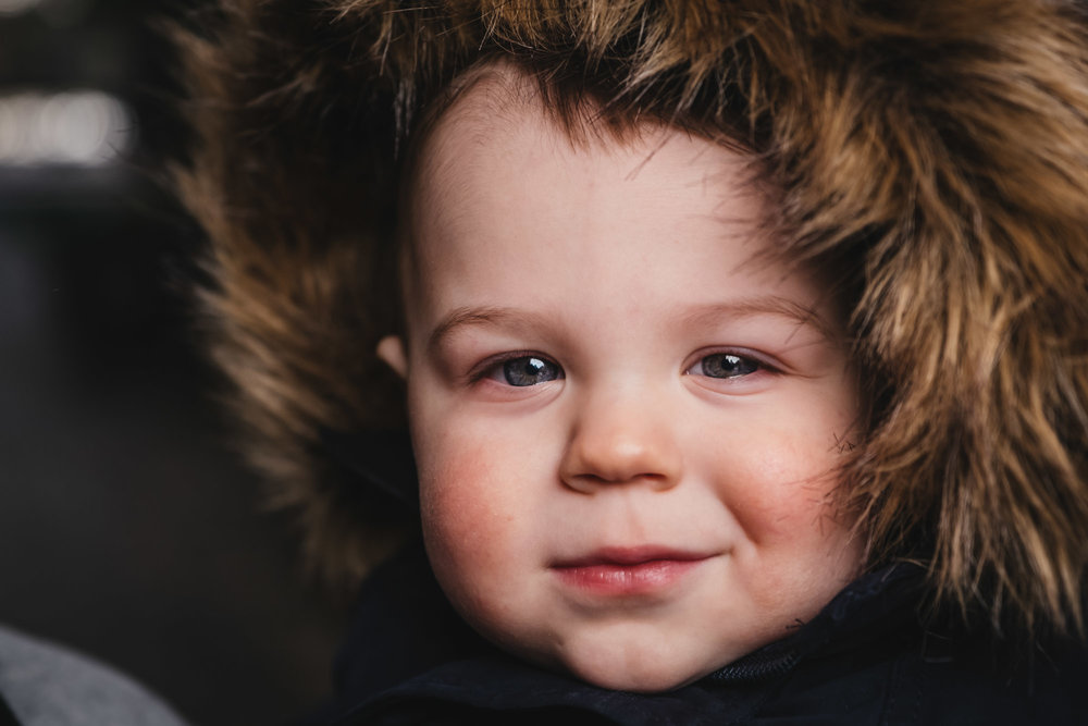 """- """"David took some amazing photos of our little guy despite less than ideal conditions (unseasonal snow and a very cranky 1 year old). He was friendly, professional, and has been so wonderful to work with after the session too."""" - Aislie"""