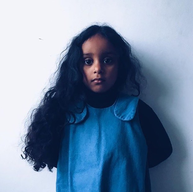 This photo is too lush not to repost. Thank you @thislakshmi for capturing your little one looking beautiful in blue. I think the Bibi Romper was designed for her to wear! #beautifulinblue #denimblue #denimlovers #otti #ottistudio #kidsfashion #childrenswear
