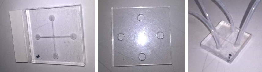 Figure 5:  Prototype laser cut microfluidic chip, showing bottom and top pieces of 5mm acrylic cut separately and assembled with tubing (left to right).