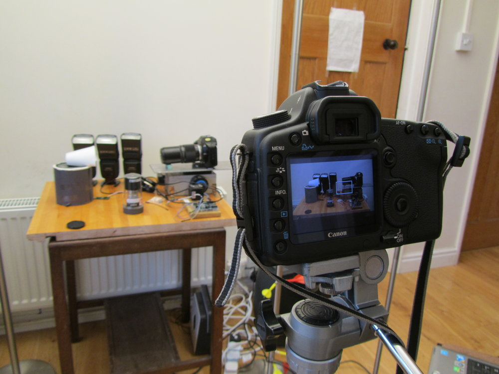 The DSLR filming the focus stacking setup, with decoy camera body in place