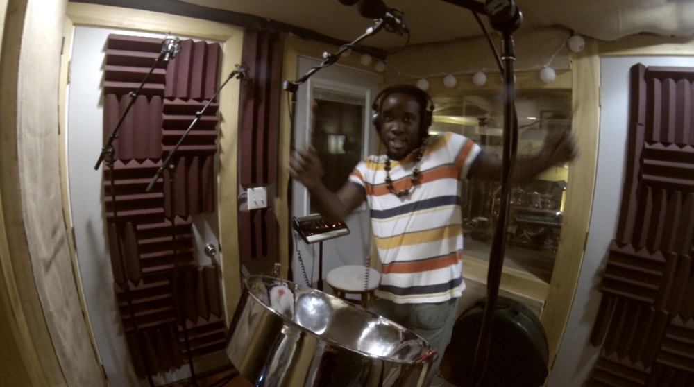 Brooks Happy with his steel pan track Merry Rockers Embrace It Recording Session .png