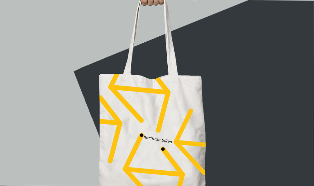 This tote bag is a playful interpretation of the logo mark as location points.