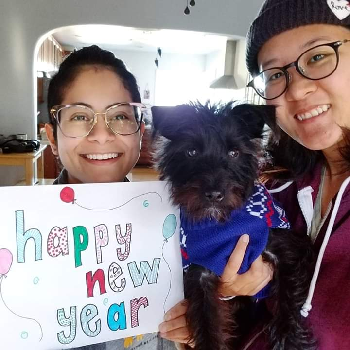 Audrey, left, with her wife, Tomomi, ring in 2019 with their 6-month puppy, Pasta.