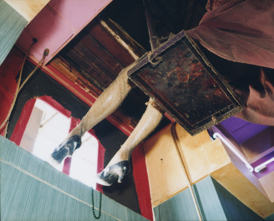 Mannequin legs on swing at Big Daddy's, New Orleans 2000