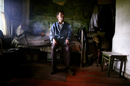 Gregory refused to evacuate his contaminated village of Bartolomeyevka. Belarus, 2003