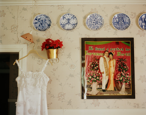 Phi's wedding dress next to a wedding photo of Bertil and her sister Kong, Vännäsby, 2008