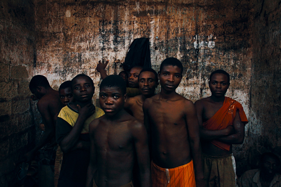 Nathalie Mohadjer. Children inside jail, Cibitoke, Burundi, 2009. By law prisoners should face trial within 14 days; most prisoners are held much longer, sometimes for up to two years. From the series Dungeon.