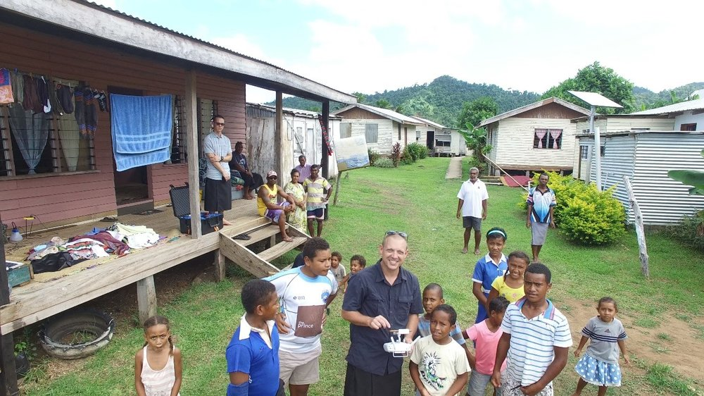 Photo: Dr Sebastian Thomas and the locals flying our quadcopter in Fiji in April 2017 Source: Sebastian Thomas