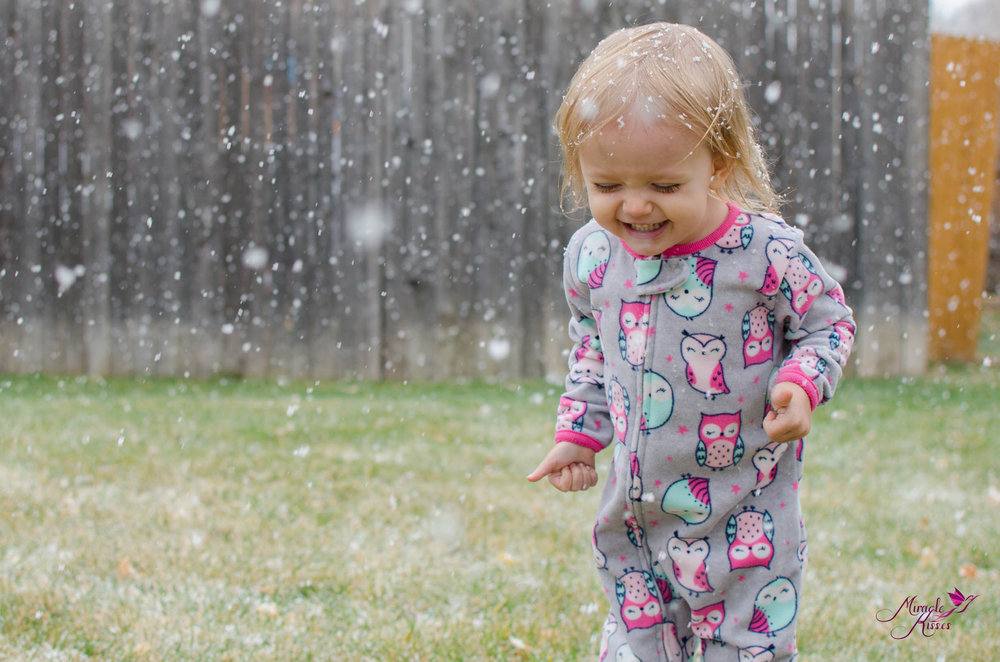 Child playing in the first snow