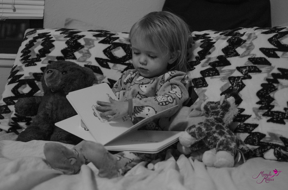 child reading a good book