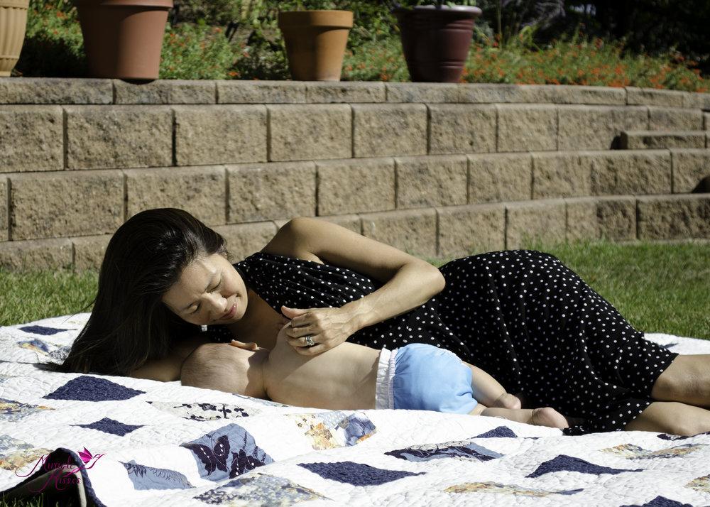 Side laying breastfeeding outside