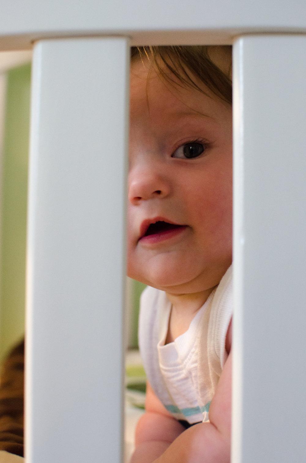6 month cutie in crib milestone