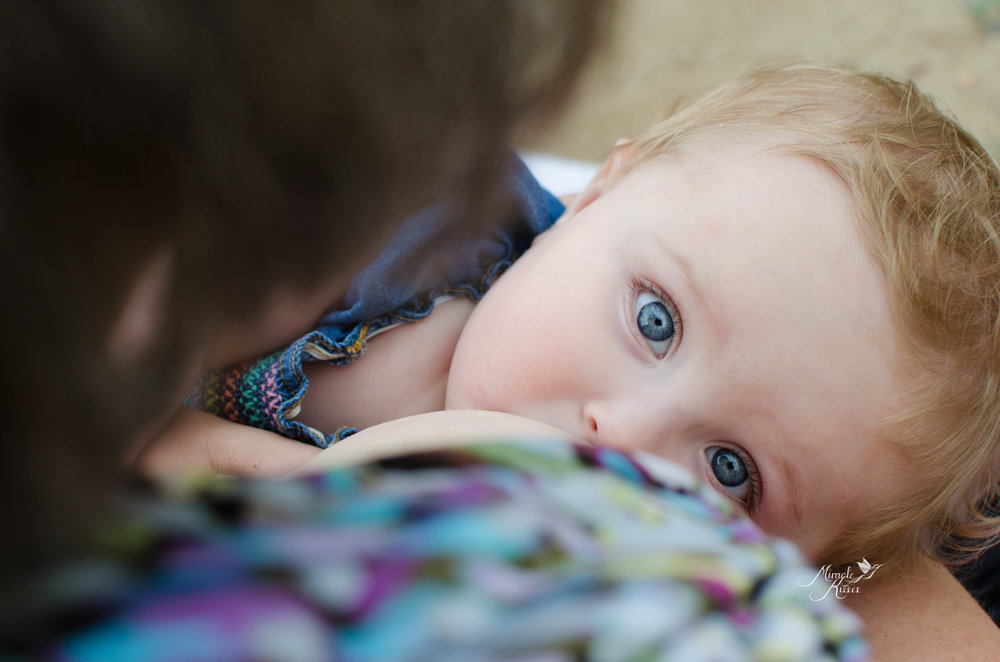 blue eyes, nursing a baby, beating the growth curve