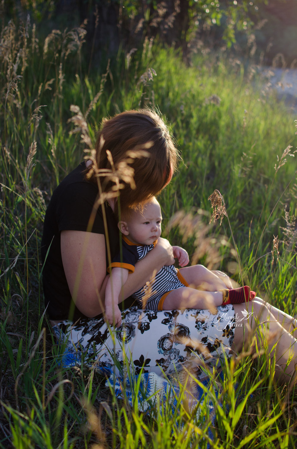 the bond project, normalize breastfeeding, mom cuddles child