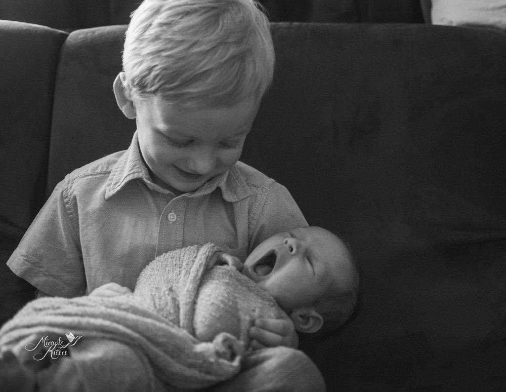 newborn sibling love, colorado newborn photography, miracle kisses