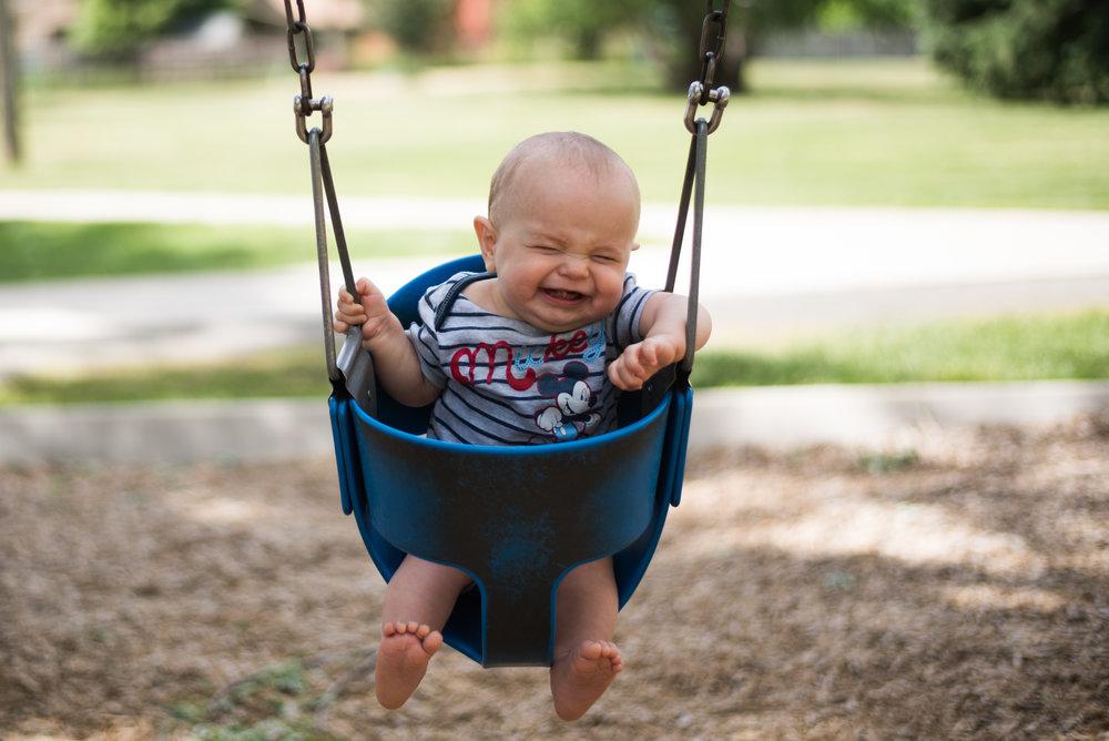 huge grin, happy baby swinging, baby swings