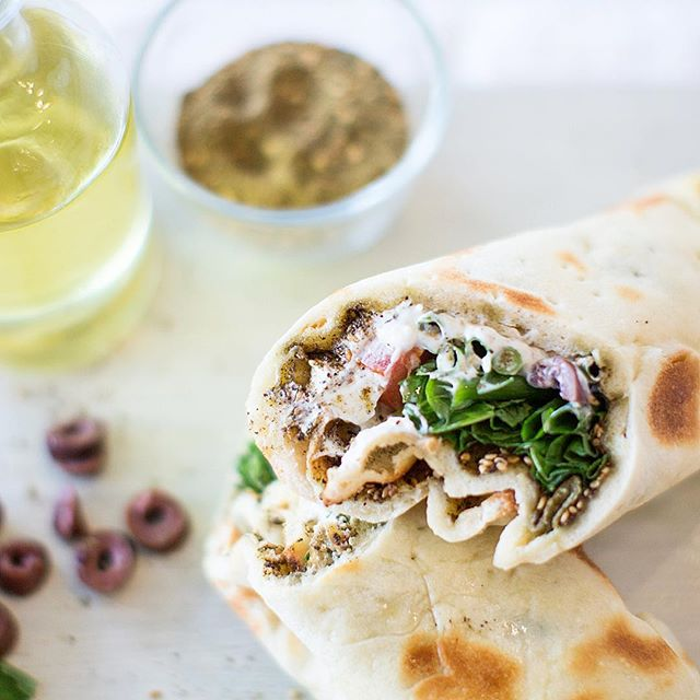 Zataar, mint, yoghurt, olives and tomatoes wrapped in warm dough. Sonia Special. A classic.