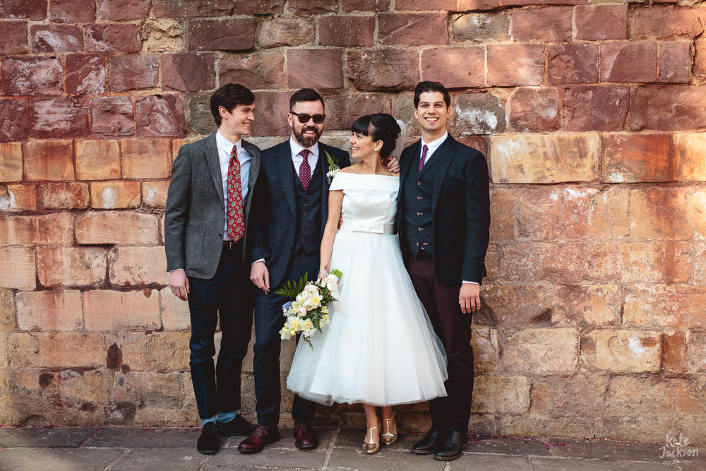 Relaxed group photos at quirky wedding in Blackfriars Priory in Gloucester