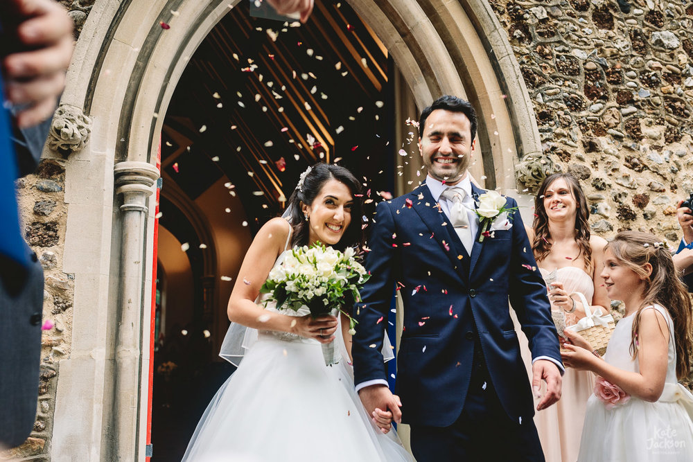 Fun Confetti photo with bride and groom at Greek London Wedding | Natural Wedding Photographer