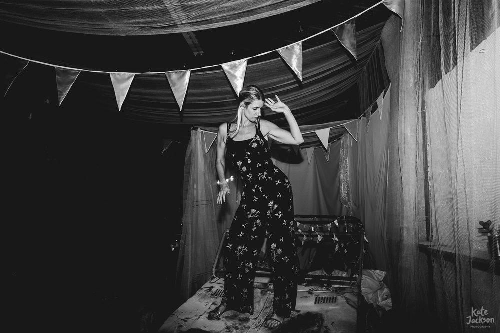 Guest dancing on photo booth car at fun barn wedding in Sheffield