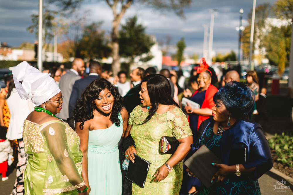 Candid and natural photo of bridesmaid and guests laughing in the sunshine at Birmingham Wedding | The Bond Weddings