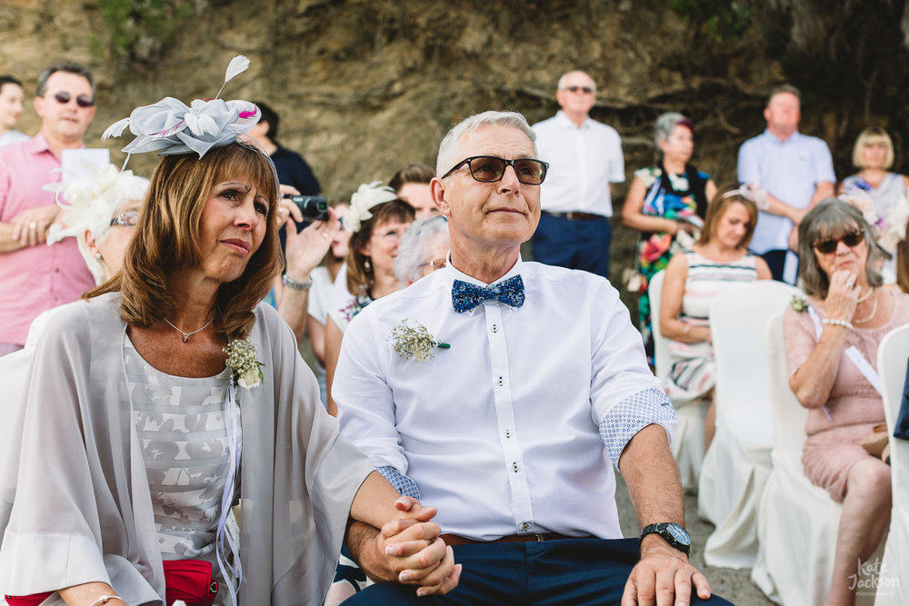 Documentary photo of Brides parents tearing up during relaxed beach wedding ceremony