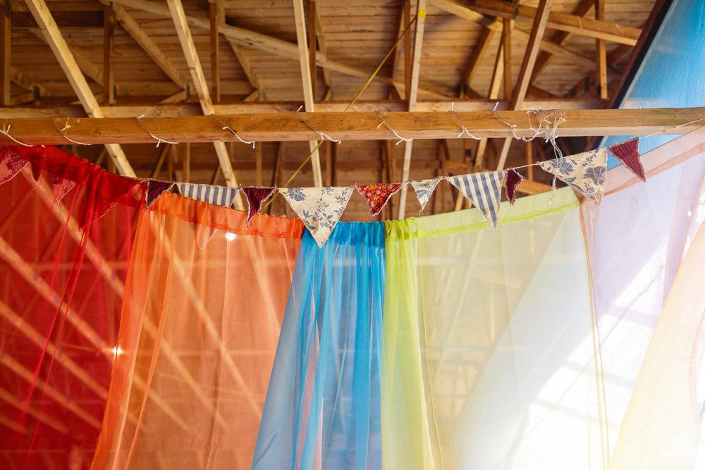 Rainbow Decor at DIY Festival Wedding in a Rustic Barn | Kate Jackson Photography